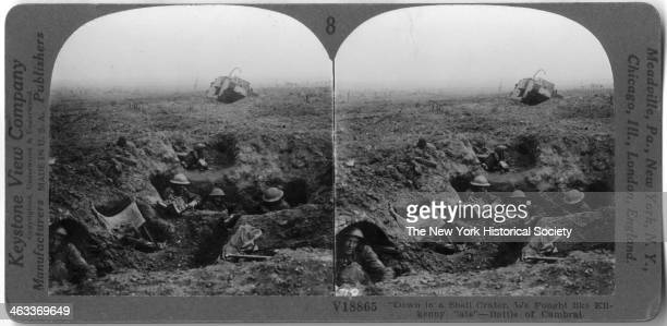 View of soldiers dug into their trenches during the Battle of Cambrai November 20 December 7 1917 A tank is visible in the background
