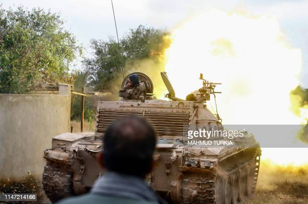 Tank loyal to the Libyan internationally-recognised Government of National Accord fires during clashes against forces loyal to strongman Khalifa...