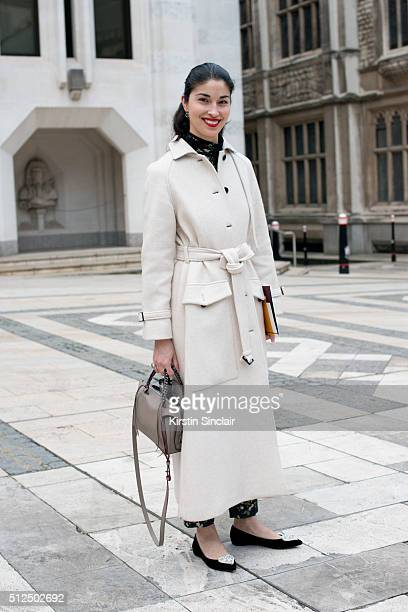 Tank magazine chief executive Caroline Issa wears a Joseph coat on day 3 during London Fashion Week Autumn/Winter 2016/17 on February 21 2016 in...