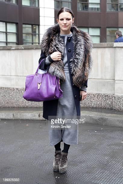 Tank magazine editor Chloe Kerman wearing Azzadine Alaia shoes Prada jacket Mother of Pearl dress Yves Saint Laurent bag street style at London...