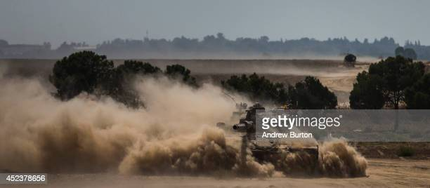 A tank moves positions near the IsraeliGaza border during an operation on July 19 2014 near Sderot Israel As operation 'Protective Edge' enters it's...