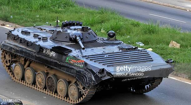 A tank of ProGbagbo militiamen patrols a street in Deux Pleaux quarter in Abidjan on April 1 2011 Ivory Coast strongman Laurent Gbagbo's forces...