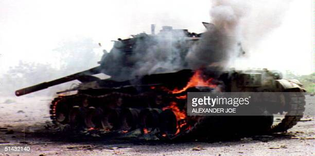 T45 tank of Somali warlord Mohamed Farah Aidid burns after being hit 12 June 1993 during the United Nations forces attack on the Mogadishu radio...