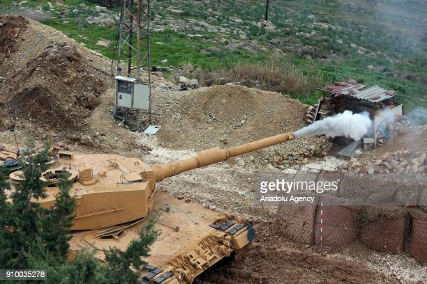 A tank of Turkish Armed Forces fires within the 'Operation Olive Branch' against PYD/PKK in Afrin Aleppo Syria on January 25 2018 Turkey launched...