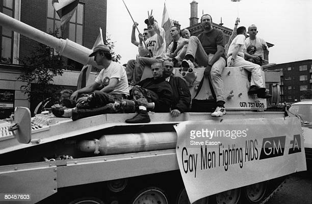 A tank on the annual Gay Pride march London carrying 'Gay Men Fighting AIDS' supporters 26th June 1995