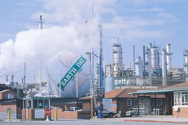 Tank painted as a globe with the words 'Earth Day 19701990' at a Unocal oil refinery in Los Angeles CA