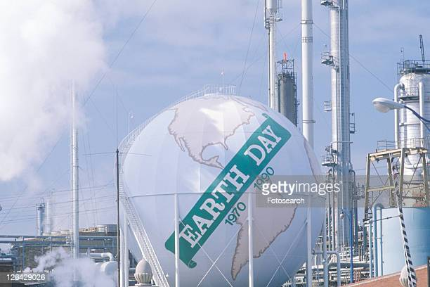 Tank painted as a globe with the words ôEarth Day 1970-1990ö at an oil refinery in USA