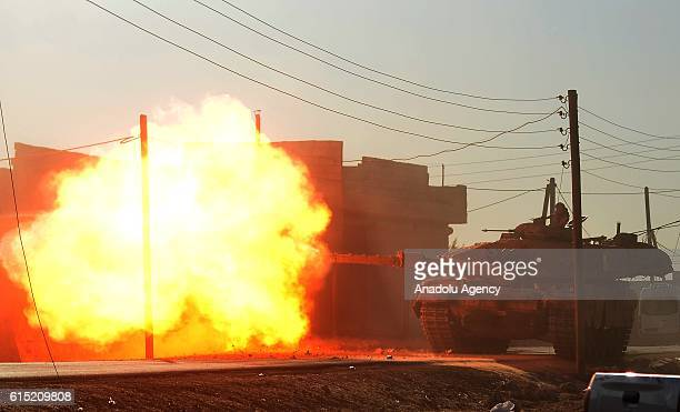A tank positioned in the secured zone between Azaz and Jarabulus Districts attacks Daesh terrorists' targets located approximately 20 km away from...