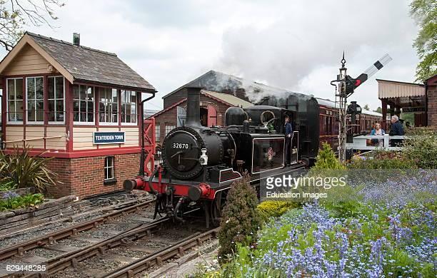 Tank steam locomotive 32670 departing Tenterden Town station.