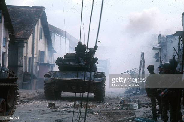 A tank through the streets of the city destroyed during the Tet offensive the Vietnamese new year night Saigon January 1968