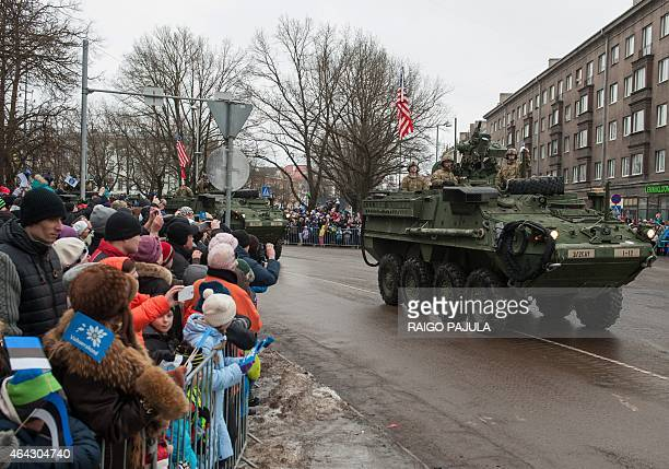 A tank with an US flag takes part in a military parade to celebrate 97 years since first achieving independence in 1918 on February 24 2015 in Narva...