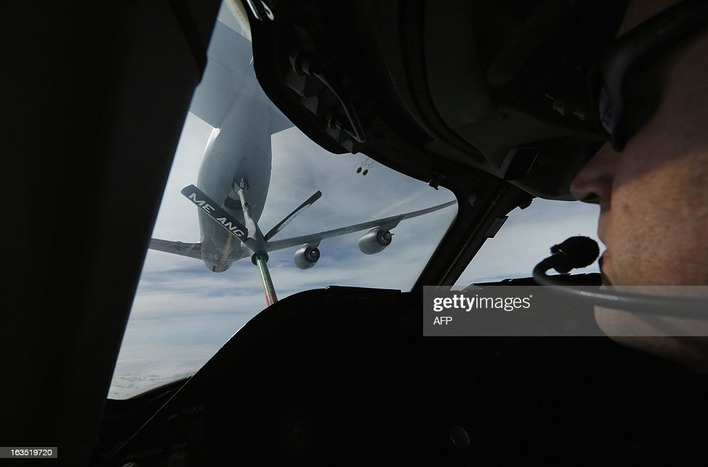 A KC-135 tanker aircraft is pictured on March 11, 2013 during a mid-air refueling over Newfoundland of US Secretary of Defense Chuck Hagel's E-4B, a militarized version of a Boeing 747, as he returns from Ramstein Airbase in Germany to Andrews Air Force Base near Washington. Faced with inflammatory remarks from Afghan President Hamid Karzai and insurgent bombings, Hagel showed an abundance of caution in his first visit to Afghanistan as America's new Pentagon chief.