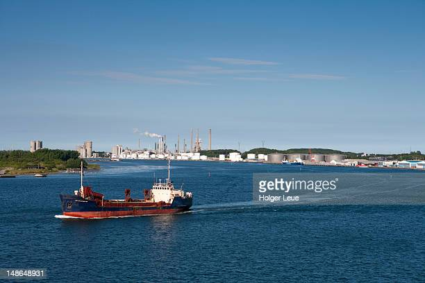 Tanker and oil tanks alongside Limfjord.