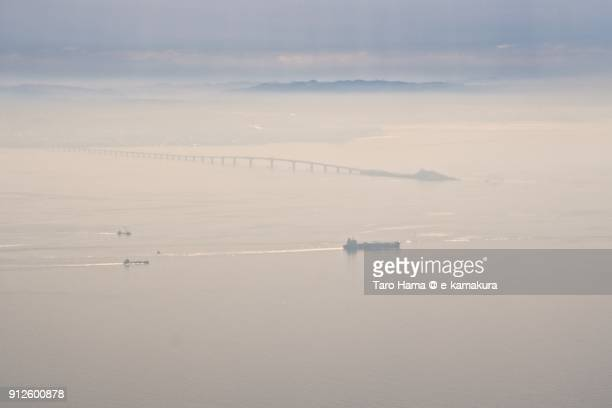 A tanker and Tokyo Bay Aqua Line in Tokyo Bay in Japan daytime aerial view from airplane