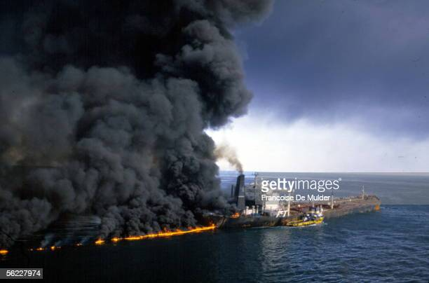 Tanker in flames during the war Iran-Iraq. Strait of Ormuz, in December, 1987.