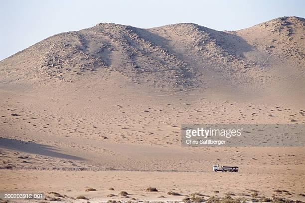 Tanker lorry crossing desert landscape