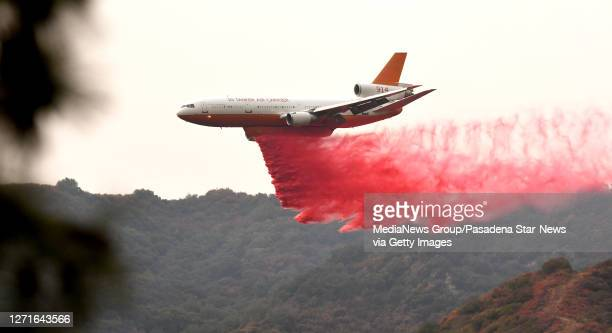Tanker makes a Phos-Chek fire retardant drop in the San Gabriel Mountains during the Bobcat Fire in Monrovia on Wednesday, September 9, 2020.