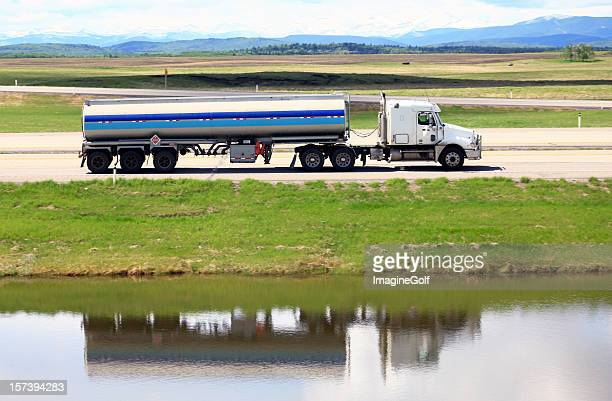 tanker semi-truck on a freeway with mountains - milk tanker stock photos and pictures