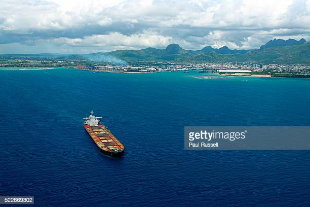 tanker ship leaving port louis - port louis stock photos and pictures
