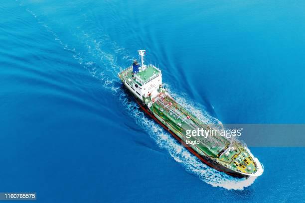 tanker ship moving on the sea. - negocios finanzas e industria fotografías e imágenes de stock
