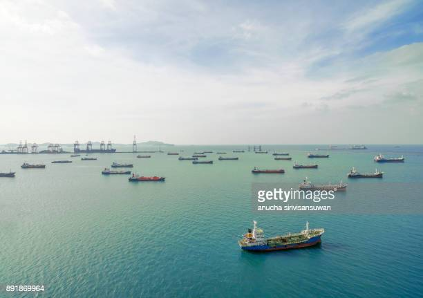 tanker ship park near oil refinery waiting for transport . - industrial sailing craft stock pictures, royalty-free photos & images