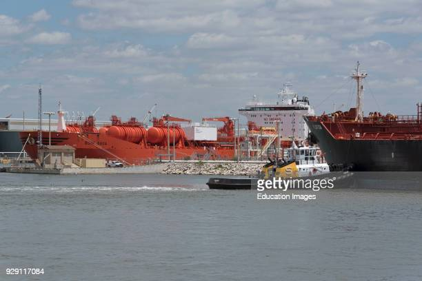 Tanker ships and a tug working in the port of Tampa Florida USA