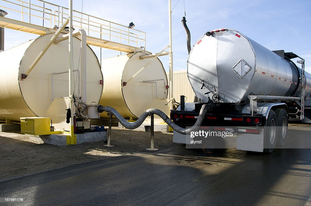 Tanker Transeferring Oil into Fuel Tanks : Stock Photo