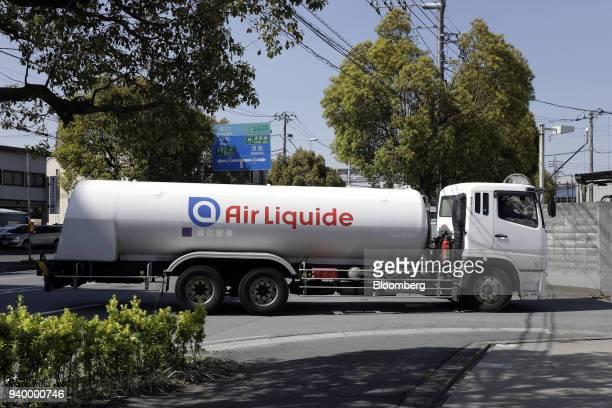 A tanker truck bearing the Air Liquide SA logo travels along a road in Kawasaki Kanagawa Prefecture Japan on Friday March 30 2018 The Kawasaki...