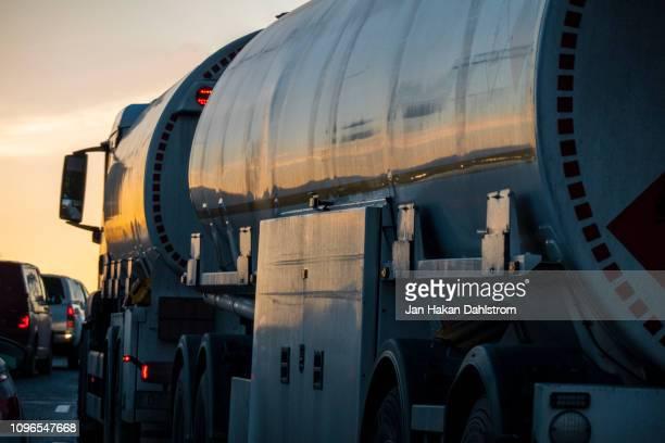Tanker truck on highway at dusk