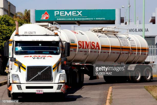 A tanker truck waits wait at a Pemex storage and distribution center to load gasoline to distribute to Pemex gas stations in El Salto Jalisco state...