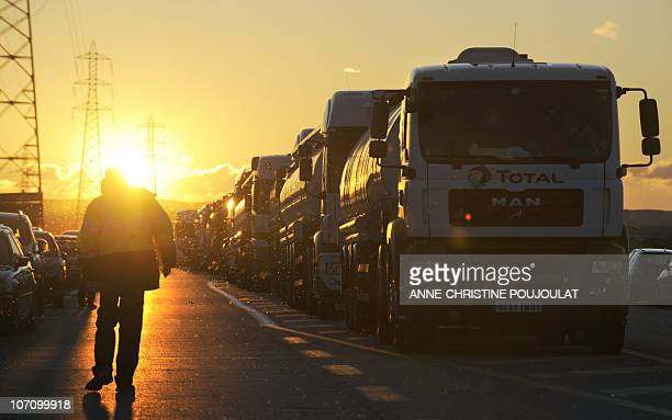 Tanker trucks are blocked by strikers protesting against plans to raise France's retirement age on their way to an oil depot at FossurMer the biggest...