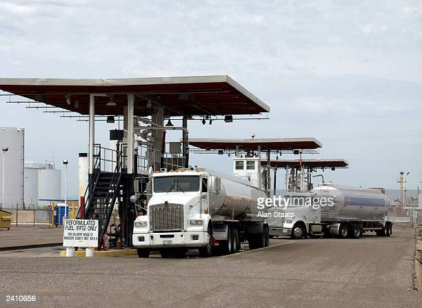 Tanker trucks are loaded with gasoline at the KinderMorgan tank farm August 19 2003 in southwest Phoenix Arizona After a gasoline pipeline that...