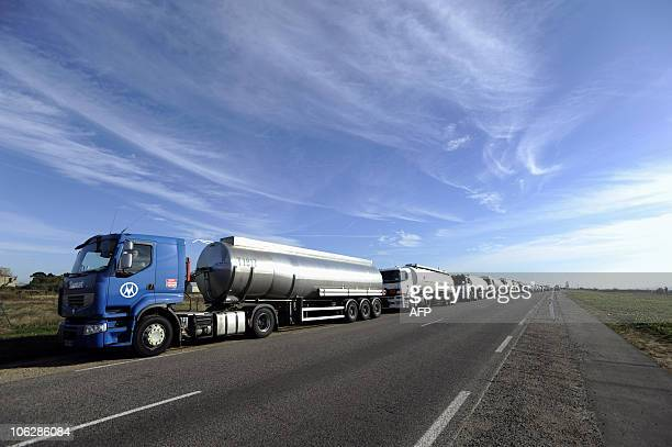Tanker trucks queue for refill on October 22 in front of the French oil giant Total refinery of Donges western France to supply gas to stations in...