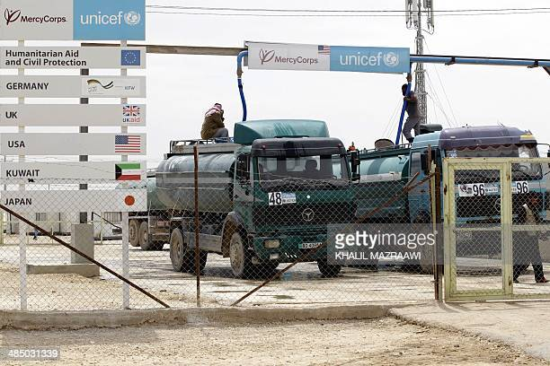 Tankers deliver clean water at the Zaatari Syrian refugee camp a sevensquarekilometre camp that is home to more than 100000 refugees on April 15 some...