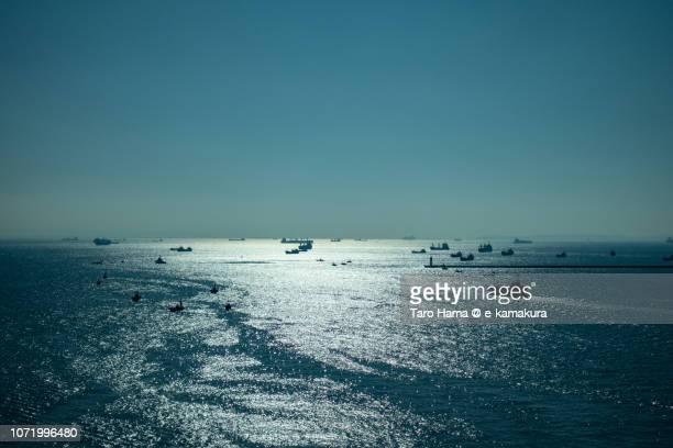 tankers sailing on tokyo bay in kanagawa prefecture in japan daytime aerial view from airplane - yokohama stock pictures, royalty-free photos & images