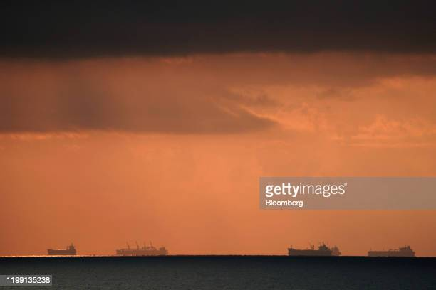 Tankers sit offshore at the port city of Balikpapan in East Kalimantan, Borneo, Indonesia, on Tuesday, Nov. 26, 2019. For Jakarta, a city on the...