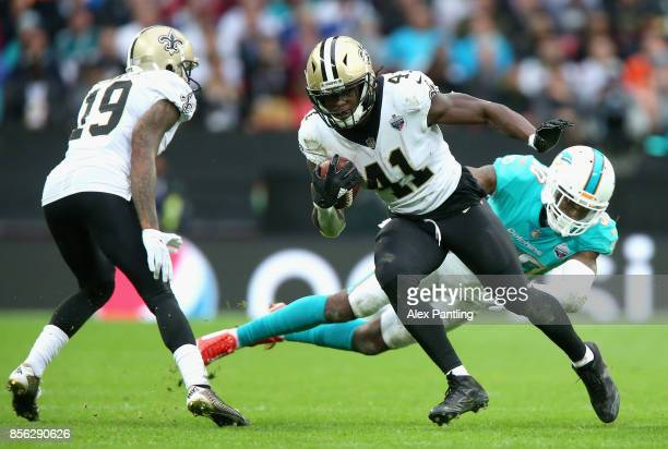 Tankersley Cordrea of Miami Dolphins tackles Alvin Kamara of New Orleans Saints during the NFL International Series match between New Orleans Saints...