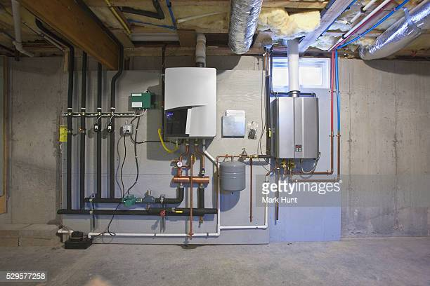Tankless hot water system in the basement of a Green Technology Home