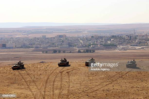 Tanks and a troop of Turkish Armed Forces are seen on the hills at the Turkey Syria borderline as the clashes near to the Turkish borderline continue...