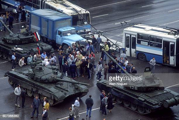 Tanks and city buses form a roadblock outside the Russian White House during a 1991 coup attempt The State Committee for the State of Emergency a...