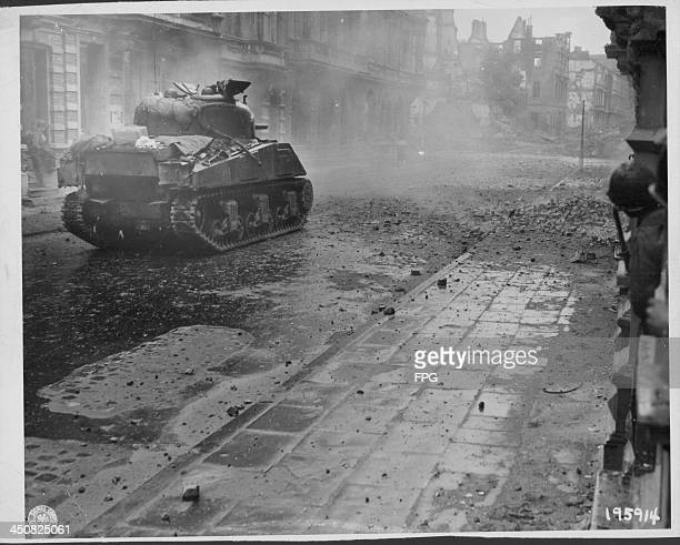 US tanks and infantry advance on German forces in the town of Aachen during World War Two Germany October 15th 1944