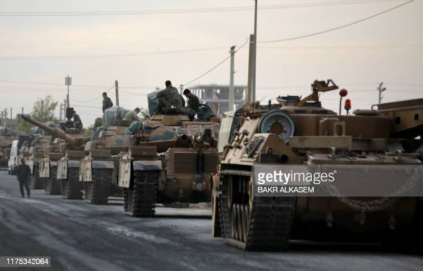 Tanks are pictured lined up as Turkish soldiers and Turkeybacked Syrian fighters deploy near the Turkish village of Akcakale along the border with...