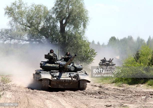 Tanks are seen during the tactical battalion exercises of a separate mechanized brigade of the North operational command of the Land Forces of the...