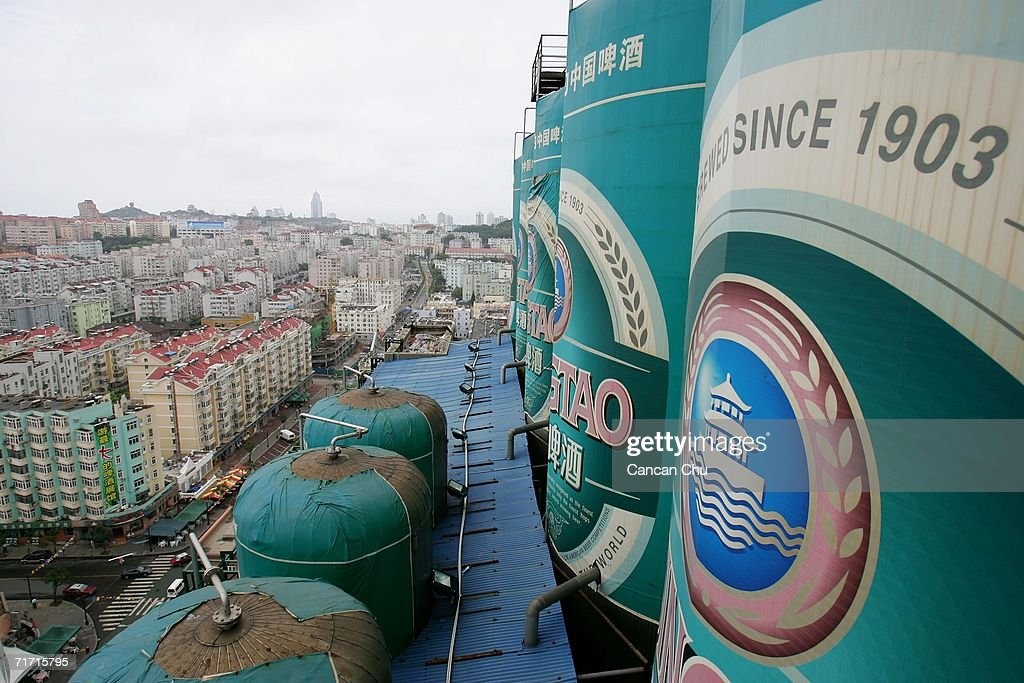 Tanks decorated as Tsingtao Beer cans are displayed on the top of a building at the Tsingtao beer factory on August 25, 2006 in Qingdao, Shandong Province of China. Tsingtao Beer Group, China's biggest beer brewery and the Official Domestic Beer Sponsor of the Beijing 2008 Olympic Games, hosts the 16th Qingdao International Beer Festival in Qingdao from August 12 to 26.