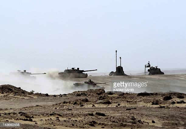 UAE tanks drive during joint military manoeuvres with the French army in the desert of Abu Dhabi May 2 2012 AFP PHOTO/KARIM SAHIB
