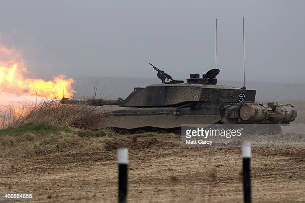 A tanks fires during Exercise Tractable on March 19 2015 in Salisbury England The threeweek major exercise involving hundreds of vehicles including...