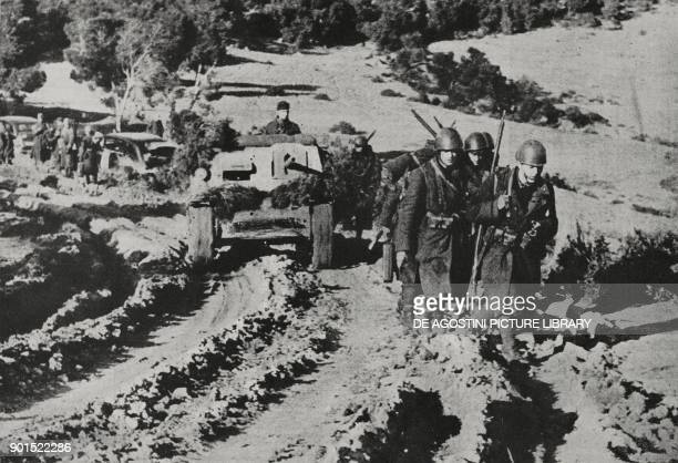Tanks flanked by Italian infantry advancing into Tunisia World War II from L'Illustrazione Italiana Year LXX No 4 January 24 1943