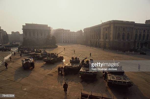 Tanks in Palace Square afterwards named Revolution Square during the Romanian Revolution December 1989 The National Museum of Art of Romania is on...