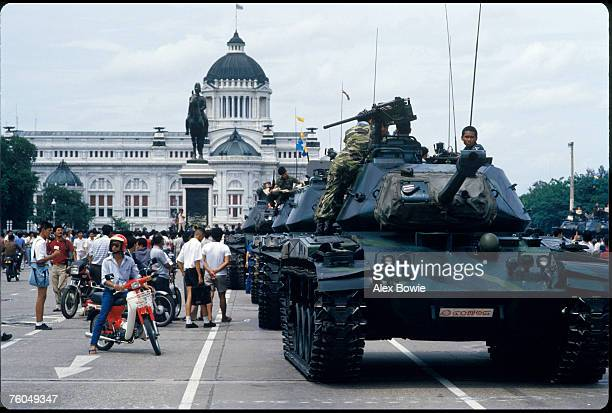 Tanks loyal to the Thai government take up position in front of the Thai parliament building in Bangkok during Thailand's 18th coup since 1932 9th...