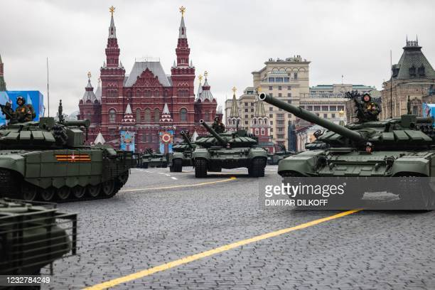Tanks move through Red Square during the Victory Day military parade in Moscow on May 9, 2021. - Russia celebrates the 76th anniversary of the...